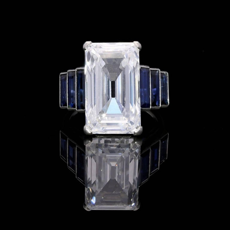 An exceptional Art Deco diamond and sapphire ring c.1920, the ring centred on a stunning emerald-cut Type IIa 'Golconda' diamond weighing 10.28 carat and of D colour and VS1 clarity, corner claw set between three graduated baguette-cut sapphires in