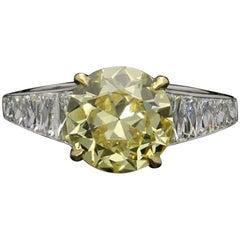 2.41 Carat Fancy Intense Yellow Diamond Ring with Tapering French-Cut Diamond