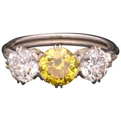 Hancocks 1.14 Carat Fancy Vivid Yellow and White Diamond Three-Stone Ring