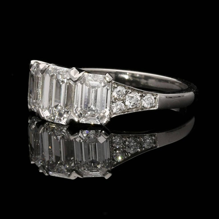 A 0.72ct Emerald cut diamond FVVS1 with GIA certificate  A 0.76ct Emerald cut diamond EVVS1 with GIA certificate  A 1.04ct Emerald cut diamond FVS1 with GIA certificate  Further 16 round brilliants diamonds totalling 0.20ct UK finger size L 1/2, US