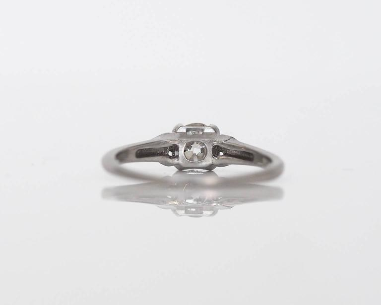Here is a classic and elegant vintage engagement ring, with intact inner hallmarks! The center diamond is a .45ct GIA certified Old European cut, with a white I color and clean SI1 clarity! There is a groove on the head of the ring leading into the
