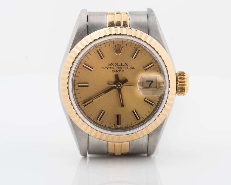 Vintage Ladies Rolex Date from 1984  Two Tone - Stainless Steel and 18 Karat Gold with Jubilee Bracelet  Champagne Stick Dial  Sapphire Crystal   Fits up to 7 inches  26mm Case  Reference # 69173, Accompanied with a Rolex box