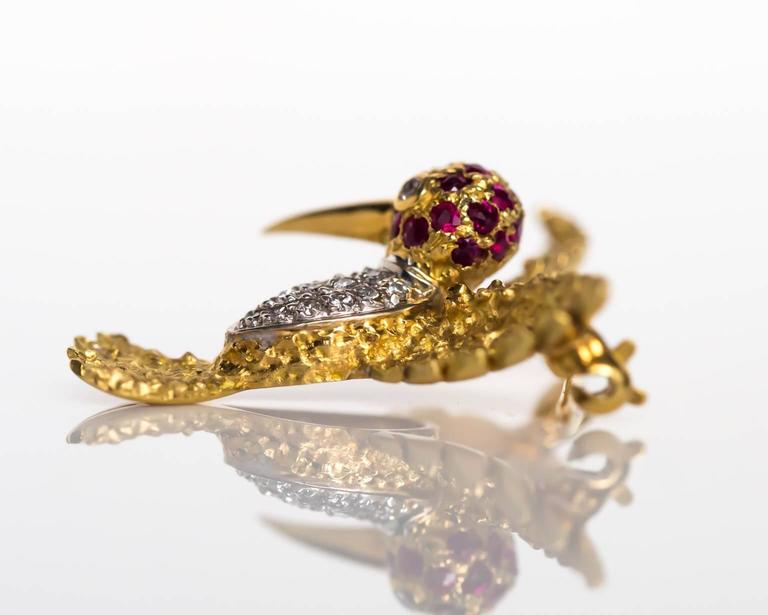 Item Details:  Metal Type: 18K Yellow Gold Weight: 5.3 grams Length: 2.5cm  Diamond Details: Carat Weight: .20 carat, total weight Color: G Clarity: VS  Color Stone Details:  Type: Ruby Carat Weigh: .20 carat, total weight. Color: Dark