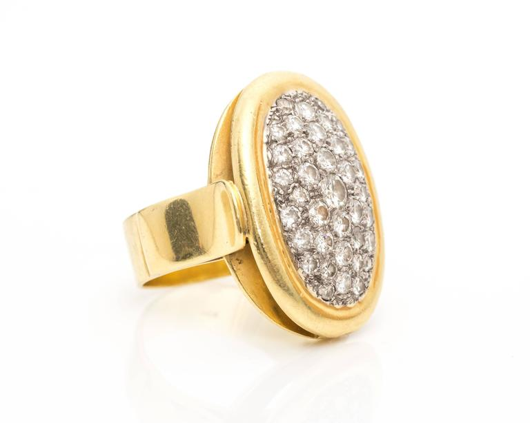 1950s Pave Diamond and 18 Karat Yellow Gold Oval Cocktail Ring measures 1 inch long by .75 inches wide, this size 7.5 ring features 1.2 carats of round brilliant diamonds set in 18 karat yellow gold. This eye-catching ring will make a statement