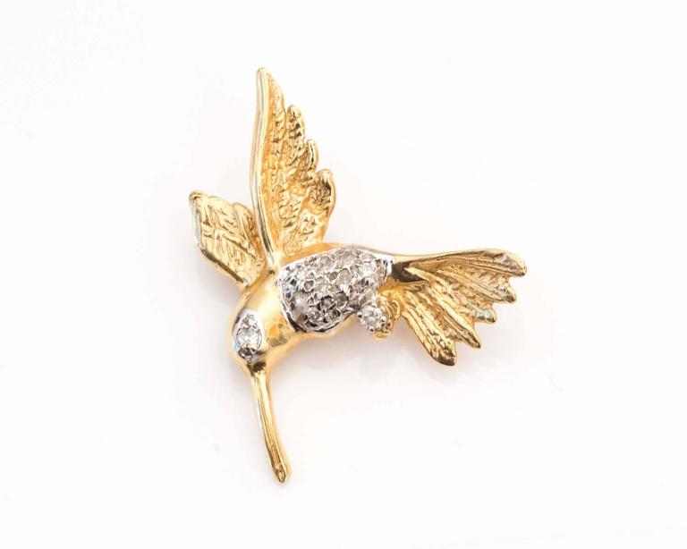 Gorgeous Brooch featuring a Hummingbird Design Simply Adorable and Elegantly Detailed  Torso and Eye of the Bird have Diamonds inlayed to the Frame with 14 Karat White Gold Remainder of the Pin is composed of 14 Karat Yellow Gold for Brilliant Shine