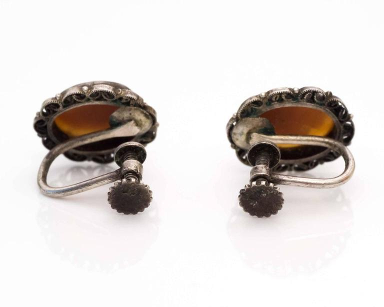 Early Victorian 1870s Cameo French Screwback Silver Earrings For Sale