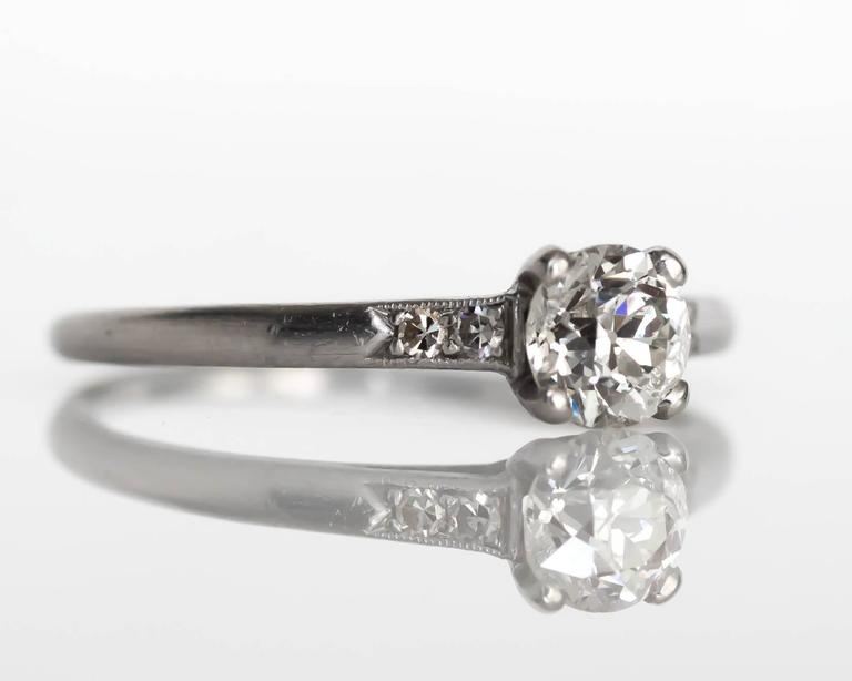 1905 Edwardian Platinum GIA Certified .66 Carat Diamond Engagement Ring In Excellent Condition For Sale In New York, NY