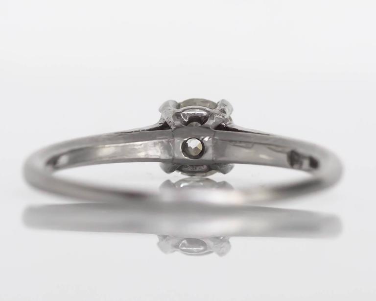 Women's 1905 Edwardian Platinum GIA Certified .66 Carat Diamond Engagement Ring For Sale