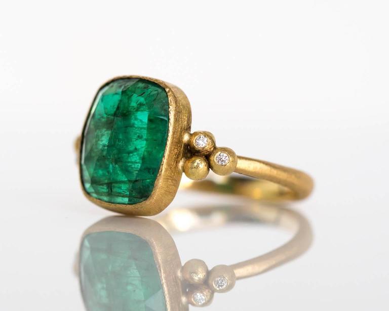 Item Details:  Ring Size: 7.25 Metal Type: 18 Karat Yellow Gold Weight: 4.2 grams  Color Stone Details:  Type: Emerald Carat Weigh: 2.00 carat Color: Green  Diamond Details:  Total Carat Weight: .05 carat, total weight Color: F Clarity: VS