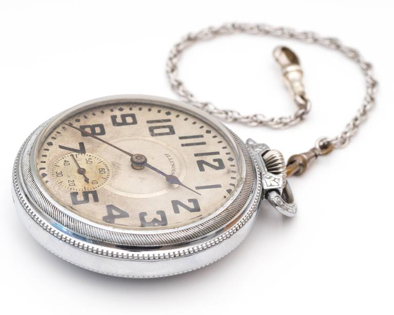 "1900s Edwardian Illinois Railroad Stainless Steel Pocket Watch. A traditional railroad Illinois watch for collector's or users alike! The surface of the watch has numbers to indicate each marker except for the number ""6"" which has another"
