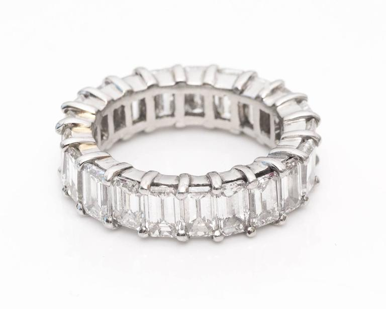 10 Carat Diamond Eternity Band, Platinum Crafted Emerald Cut Diamonds H Color, VS Clarity  All Prong Set Diamonds Fits Ring Size 8.25 The diamonds can be set into a new style setting and can be made to most sizes.  5.5 millimeter x 3.8 millimeter