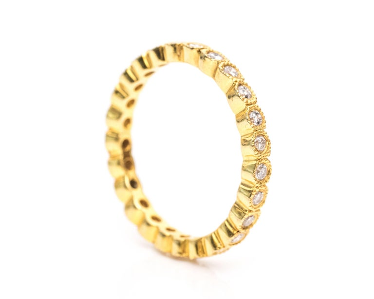 1990s Diamond and 14 Karat Yellow Gold Eternity Band Ring In Good Condition For Sale In Hicksville, NY