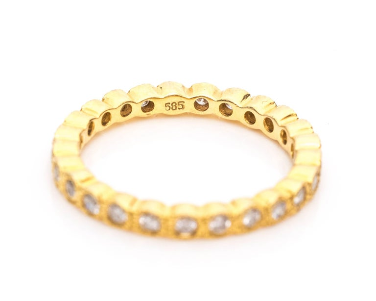 Women's 1990s Diamond and 14 Karat Yellow Gold Eternity Band Ring For Sale