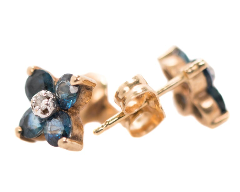 1970s Floral Stud Earrings - 14 Karat Yellow Gold, White Gold, Sapphires, Diamonds  Features: 4-Petal Flower Design 14 Karat Yellow Gold setting for Sapphires, posts and backs 14 Karat White Gold setting for each Diamond 8 deep blue Sapphires, 4 per