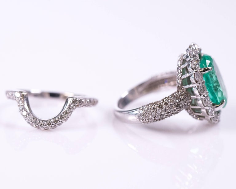 This Wedding Ring Set Features A Gorgeous 5 Carat Emerald Diamond Accompanied With