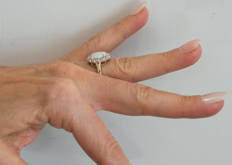 1960s Opal and Diamond Halo 14 Karat Yellow Gold Ring For Sale 3