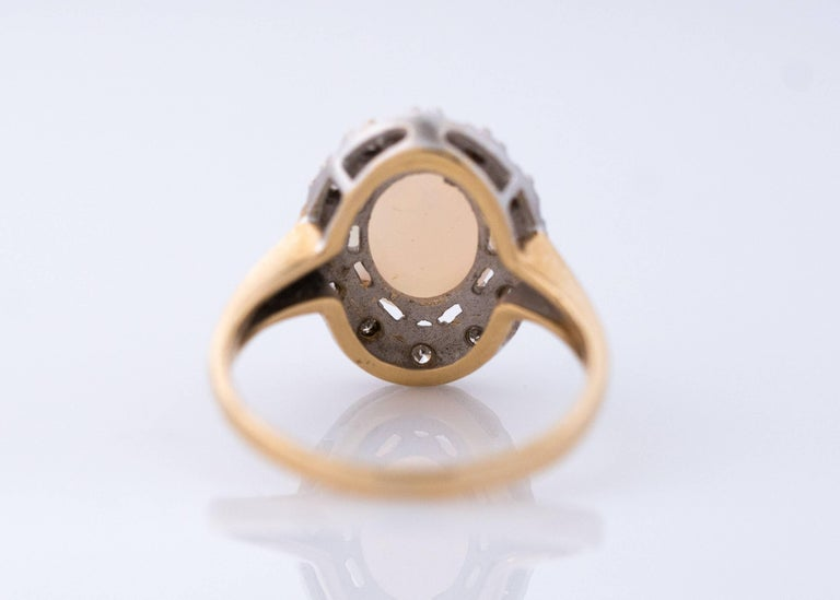 Retro 1960s Opal and Diamond Halo 14 Karat Yellow Gold Ring For Sale