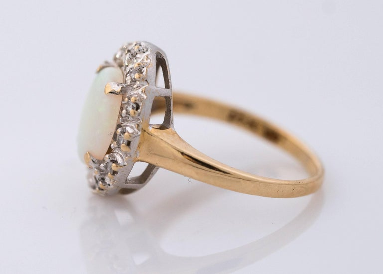 1960s Opal and Diamond Halo 14 Karat Yellow Gold Ring In Good Condition For Sale In Hicksville, NY