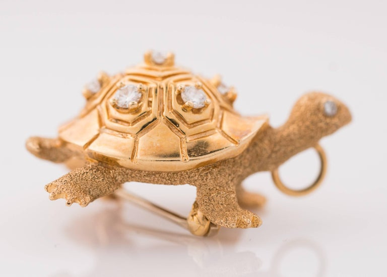 1950s Turtle Brooch, 14K Yellow Gold and Diamonds. Features .40 carats total weight of Round Brilliant Diamonds. This exquisitely detailed Turtle Pin has Sand Finish legs, head, tail and body. The high polish shell is engraved with traditional