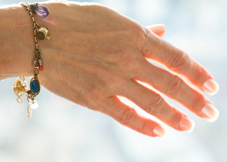 Women's 1890s Victorian Charm Bracelet in 9 Karat and 14 Karat Yellow Gold For Sale
