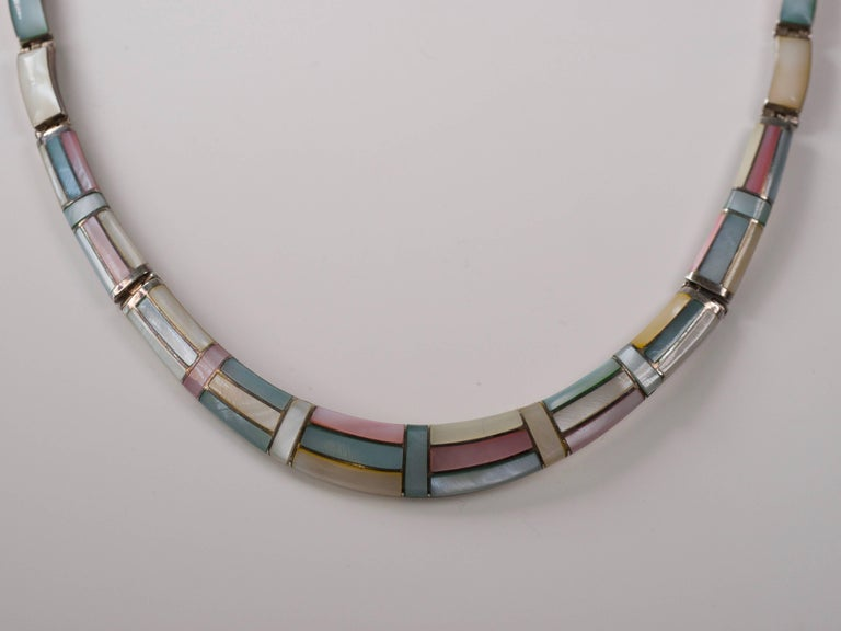 1950s Natural Pastel Shell Inlay with .950 Sterling Silver necklace.  Features Pastel Pink, Light Blue, White and Winter White polished shell inlaid in Sterling silver. The Geometric pattern accentuates the color play and opalescence of the