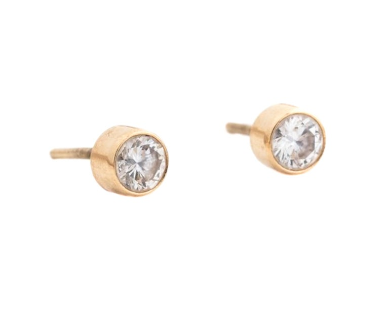 1980s Diamond Earrings, Screw Back - 14k Yellow Gold, Diamonds  The Round Brilliant Diamonds are surrounded by a 14k yellow gold bezel frame. The earrings measure 4.5 millimeters across.  The backs are not included in the photos, but are included