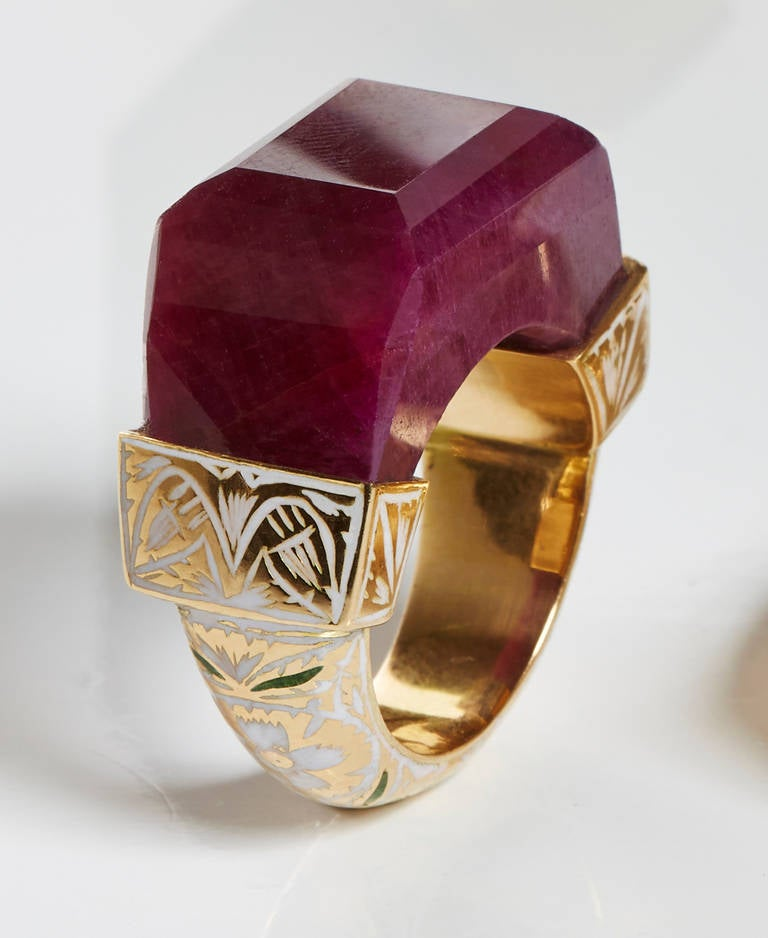 Hand Carved Ruby Ring Set in 18k Yellow Gold Band With Intricate White Enamel Work.