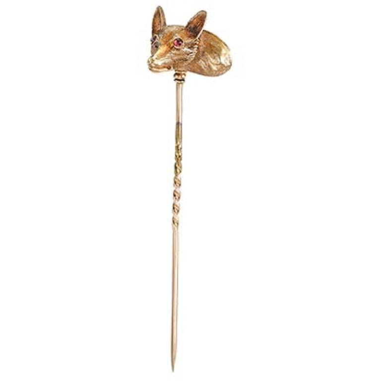 Victorian fine fox head stick pin with glass frame back and ruby cabochon eyes
