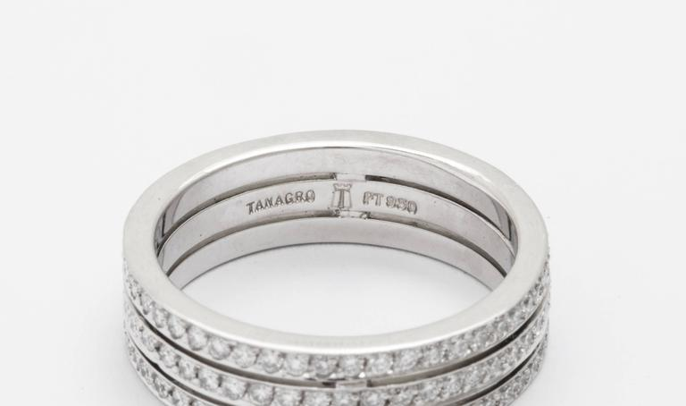Tanagro Classic everlasting style, three band like wide hand made band in Platinum 950, with all around eternity pave' set diamonds for a total of 1.00 carat weight.  Size 6,