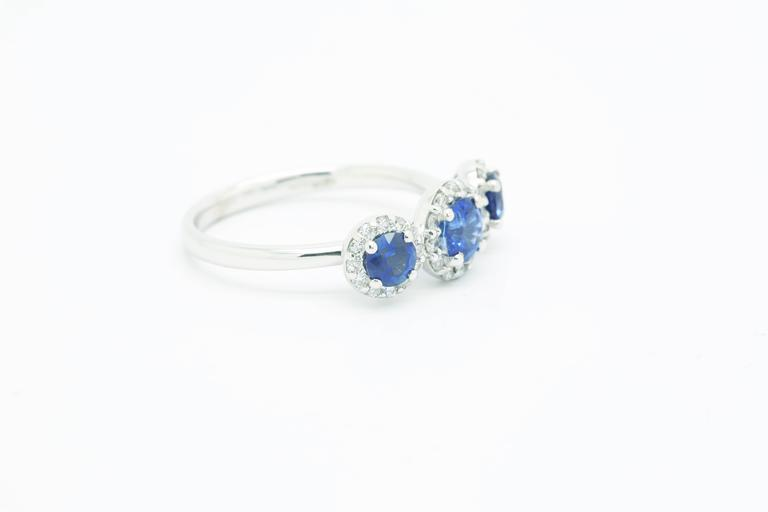 Trilogy of three Blue Sapphires adorned by bright white diamond halos by FERRUCCI, showcasing a diamond's total carat weight of 0.36ct and sapphires of 1.26 ct, entirely handcrafted in 18k white gold, Made in Italy