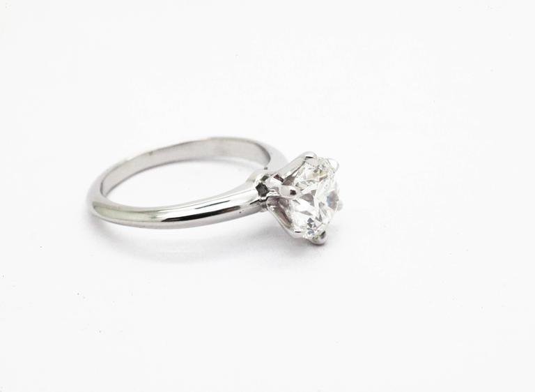 Perfectly hand crafted Platinum solitaire engagement ring by FERRUCCI,  with six claw shaped prong and classic, everlasting, style shank. Entirely made in New York City by Italian master jeweler showcasing a stunning GIA Certified round brilliant