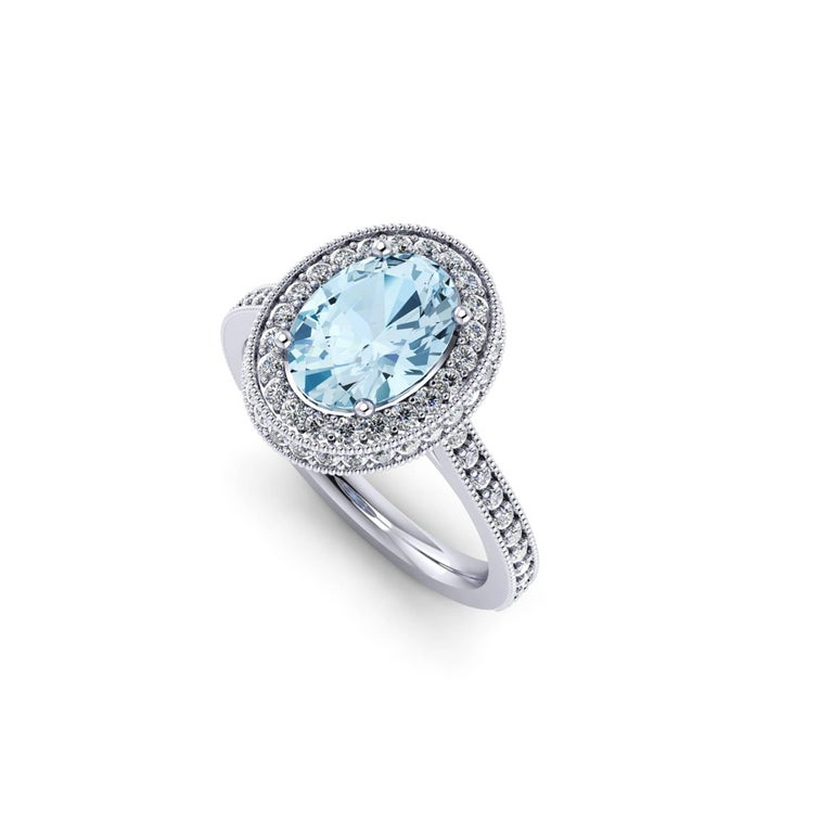Ferrucci 1.40 carat natural oval Aquamarine adorned by a double halo of round bright diamonds for a total carat weight of 0.51 carats, conceived in a hand made 18k white gold ring.  Handcrafted with the best Italian manufacturing quality, a classic