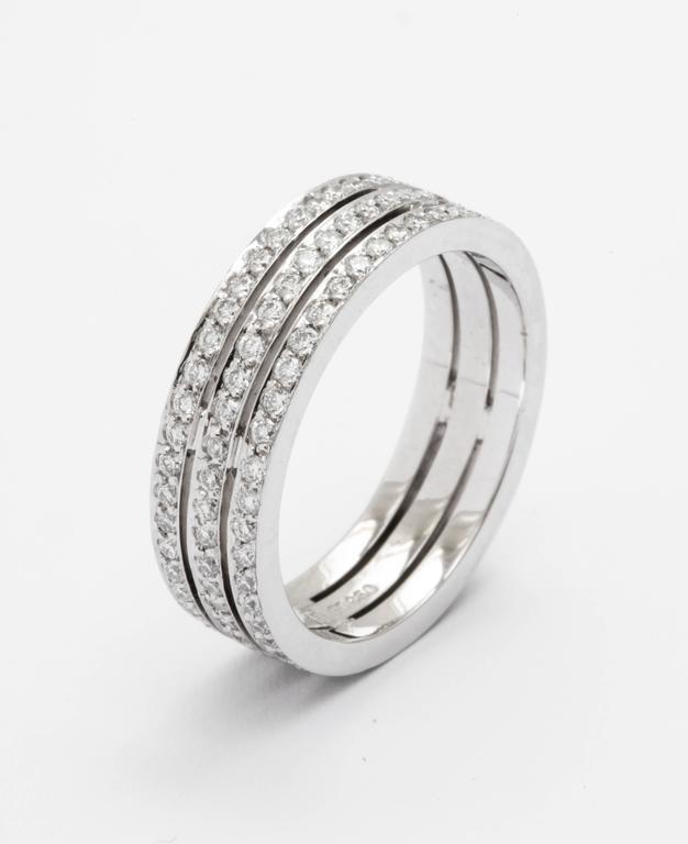 Modern Tanagro 1.00 Carat Diamonds Eternity Triple Platinum Band Ring For Sale