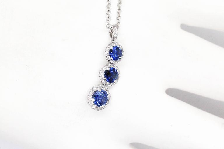 Round Cut 1.24 carat Sapphire and0.40 carat white diamonds 18k white Gold Triple Pendant For Sale