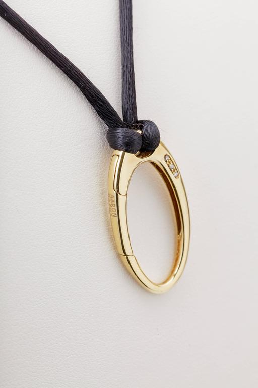 Aaron basha oval pendant clasp on black cord 18 karat gold diamond this aaron basha oval pendant clasp is 18k yellow gold and is set with three diamonds mozeypictures Image collections