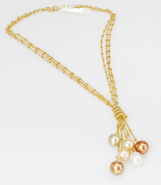 This Yvel necklace features six South Sea pearls hanging from 18k yellow gold and is set with diamonds totaling 0.26ct.  The chain measures 16 inches long.