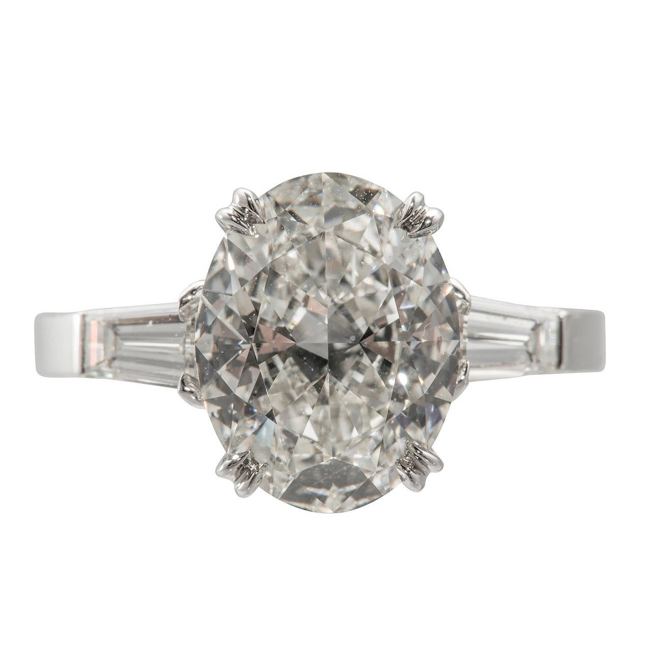 Platinum Engagement Ring With Oval Diamond And Two Tapered Baguettes 1