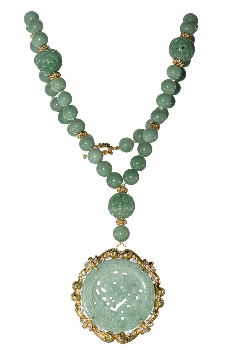 Antique Jade Surrounded by 18 karat gold and Diamonds. The pendant/brooch is detachable.