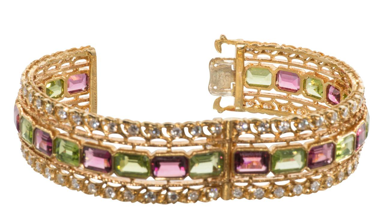 Buccellati  rublite,peridot and diamond 18k gold bangle bracelet. Diamonds= 4.20ct.tw  Rublite=approx. 20ct. tw  Peridot=approx. 20ct.tw