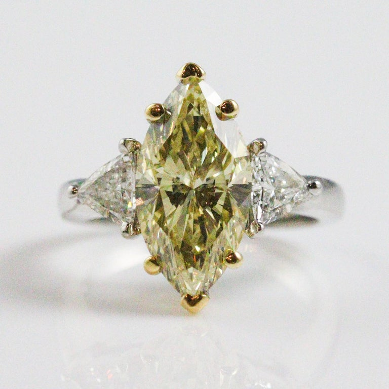 3.60 Carat GIA Certified Marquise Cut Fancy Light Brownish Yellow Diamond Ring For Sale 4