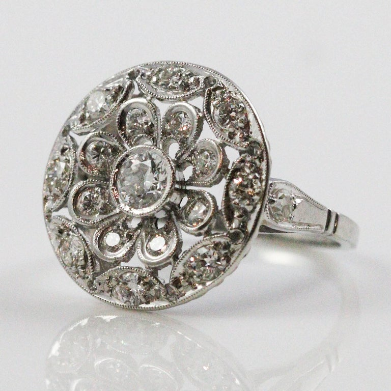Art deco platinum and european cut diamond circle motif for What is platinum jewelry made of