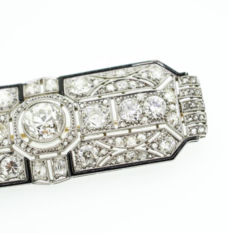 Women's or Men's Art Deco Black Enamel 8.00 Carats Diamonds Platinum Filigree Brooch For Sale