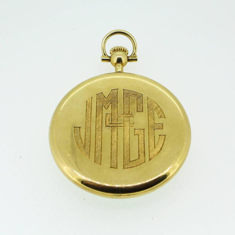 A vintage Tiffany & Co pocket watch in 18k yellow gold with a white face and gold numerals. The watch appears to be working and is in excellent condition, and the back is monogrammed. The 17 jewel movement and case is signed