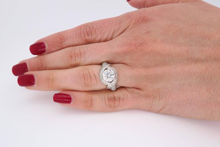 Authentic Tiffany & Co. ring is master designer Jean Schlumberger's signature engagement ring. The Platinum ring features a beautiful 1.54CT Round Brilliant Cut Diamond certified by Tiffany & Co. The featured Diamond has H color and VVS2 clarity.