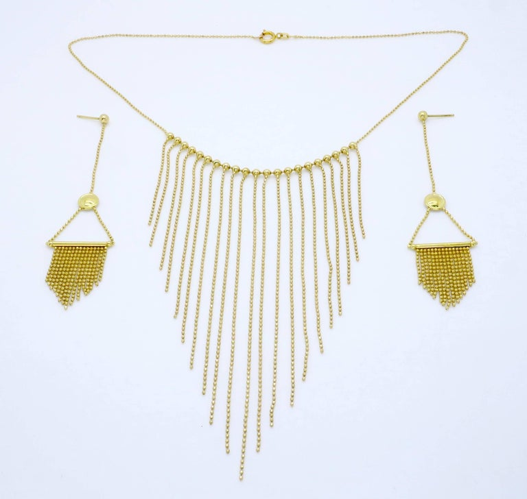 """Necklace and earring set is 18K yellow gold. The necklace is 16.5"""" in length. The earrings and necklace weigh 21 grams. We would offer the items individually as well if interested in only one and not the other."""