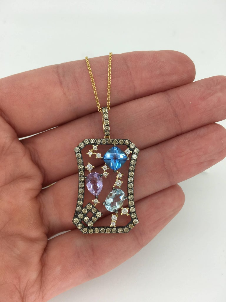 Stunning LeVian Abstract Multi Gemstone and Diamond Necklace  Designer: LeVian Gemstone: Cushion Shaped Topaz, Oval Shaped Aquamarine, Pear Shaped Amethyst Diamond Carat Weight: Approximately 1.40CTW Diamond Cut: 71 Round Brilliant  Color: 58