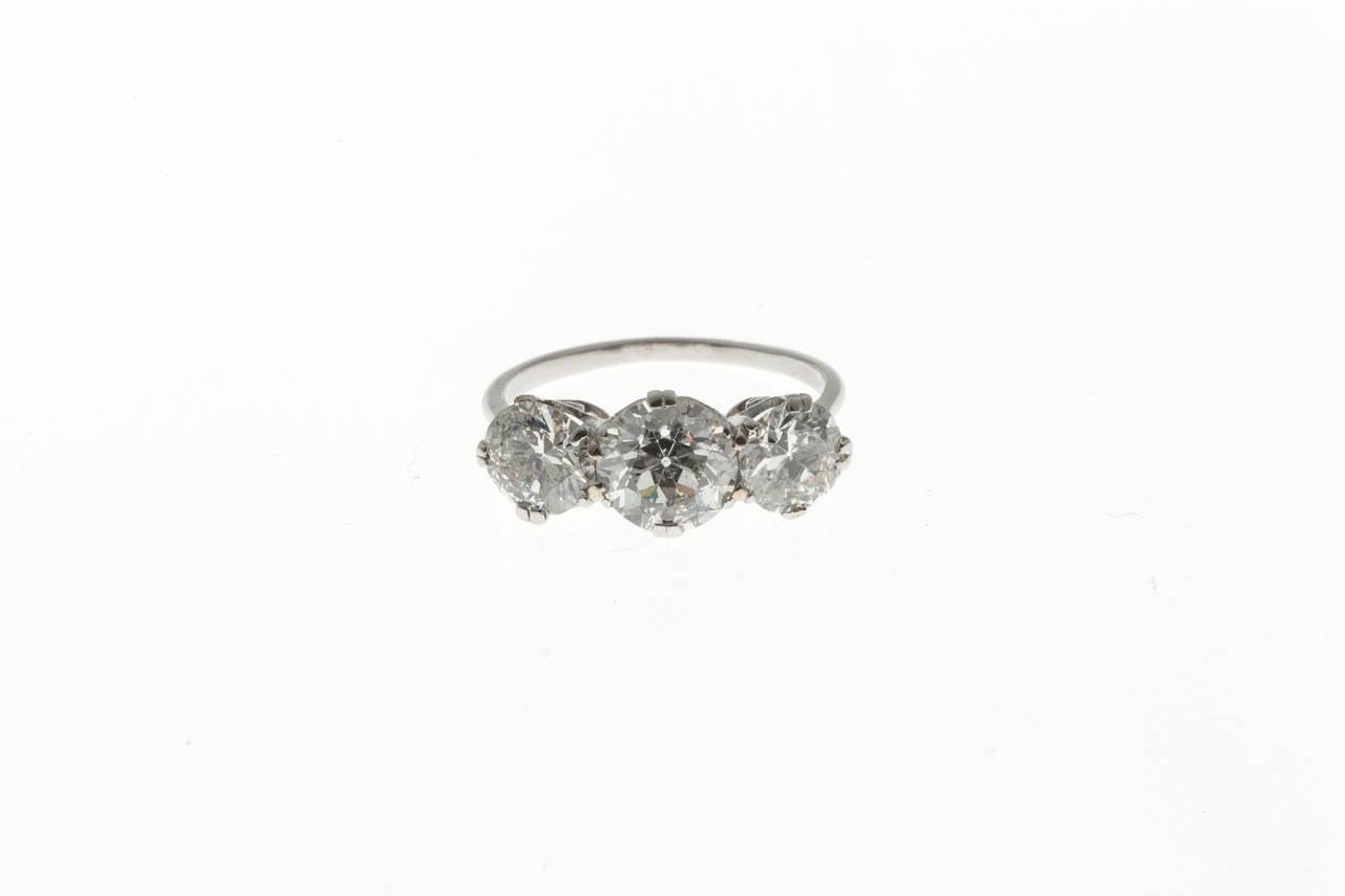 Art Deco Classic Three Stone Diamond Platinum Engagement Ring For Sale