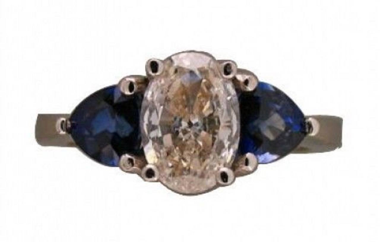 Oval Diamond and Trillion Cut Ceylon Sapphire Platinum Ring 6