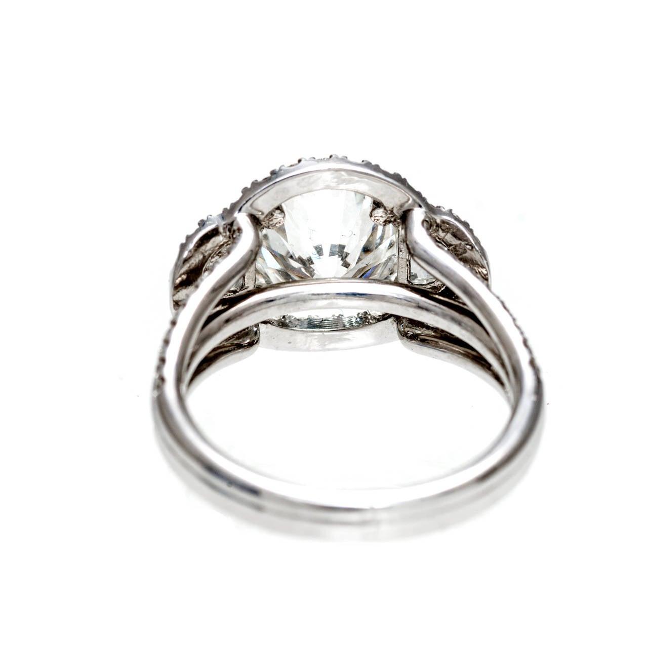 Halo ideal brilliant cut diamond platinum ring for sale at 1stdibs