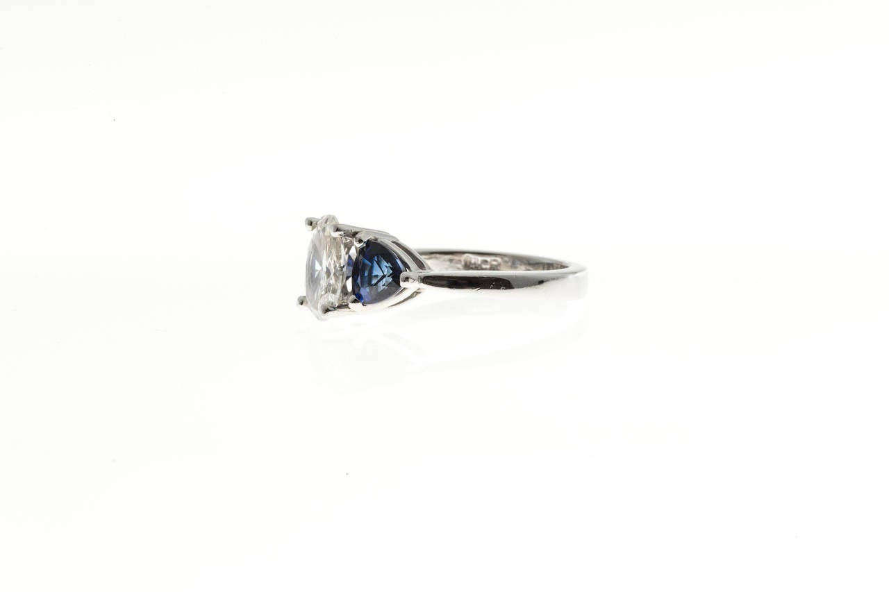 Oval Diamond and Trillion Cut Ceylon Sapphire Platinum Ring 7